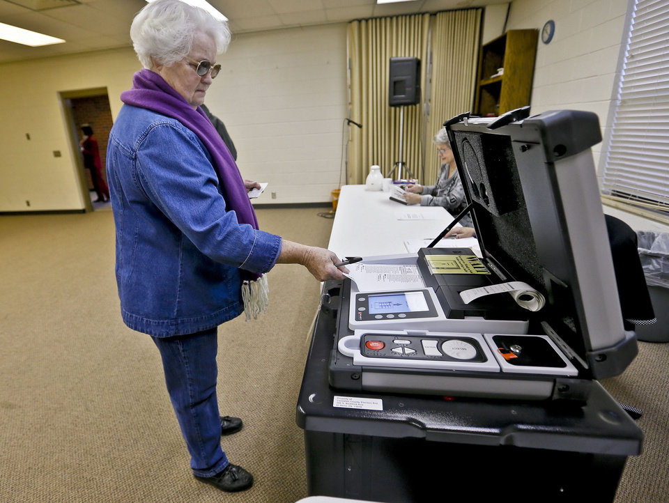 Photo - Barbara Fox cast her vote Tuesday at the First Baptist Church in El Reno in a bond to fund a high school math and science wing on what is now the site of the church.  Photo by Chris Landsberger, The Oklahoman