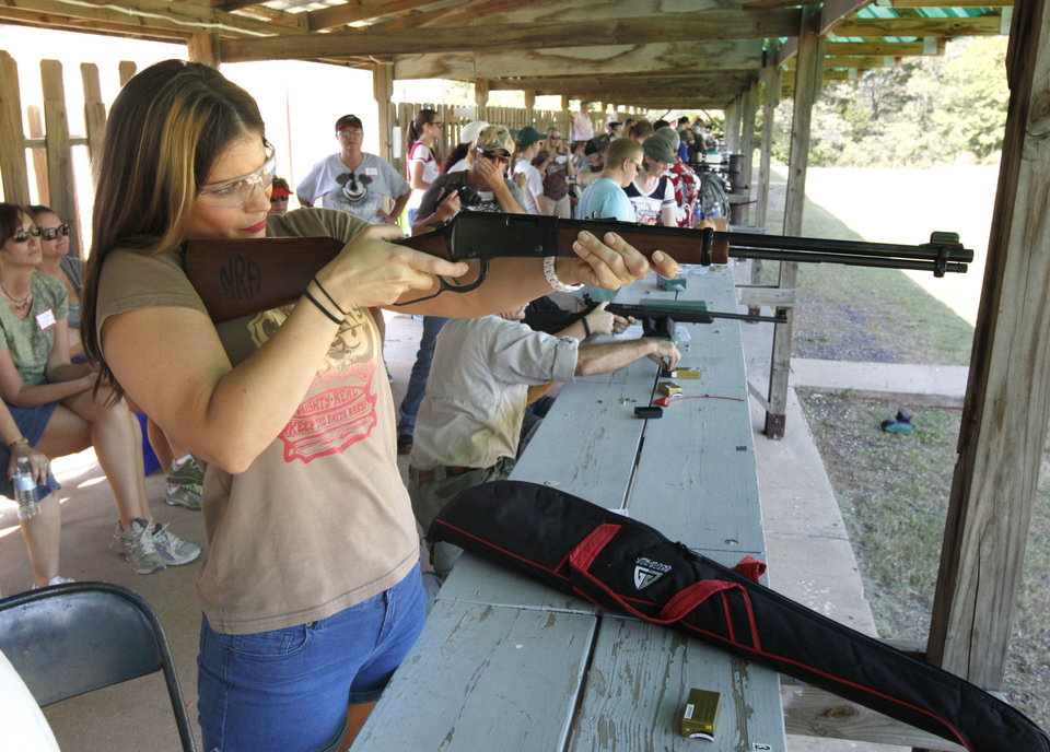 OKC resident Laura Oden shoots a lever action rifle during the annual Women's Only Fun Shoot at the Oklahoma City Gun Club north of Arcadia, OK, Saturday, September 7, 2013,  Photo by Paul Hellstern, The Oklahoman