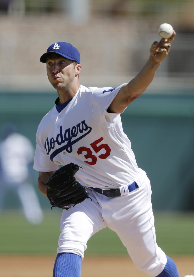 Photo - Los Angeles Dodgers starting pitcher Chris Capuano throws to the Oakland Athletics during the third inning of a spring training baseball game on Tuesday, March 19, 2013 in Glendale, Ariz. (AP Photo/Marcio Jose Sanchez)