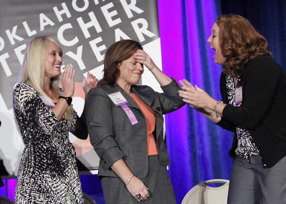 Photo - State Teacher of the Year winner Elaine Hutchison, center, reacts when her name was announced at a ceremony in the Carriage Hall at the Oklahoma State Fair, Tuesday, September 18, 2012. Photo By David McDaniel/The Oklahoman