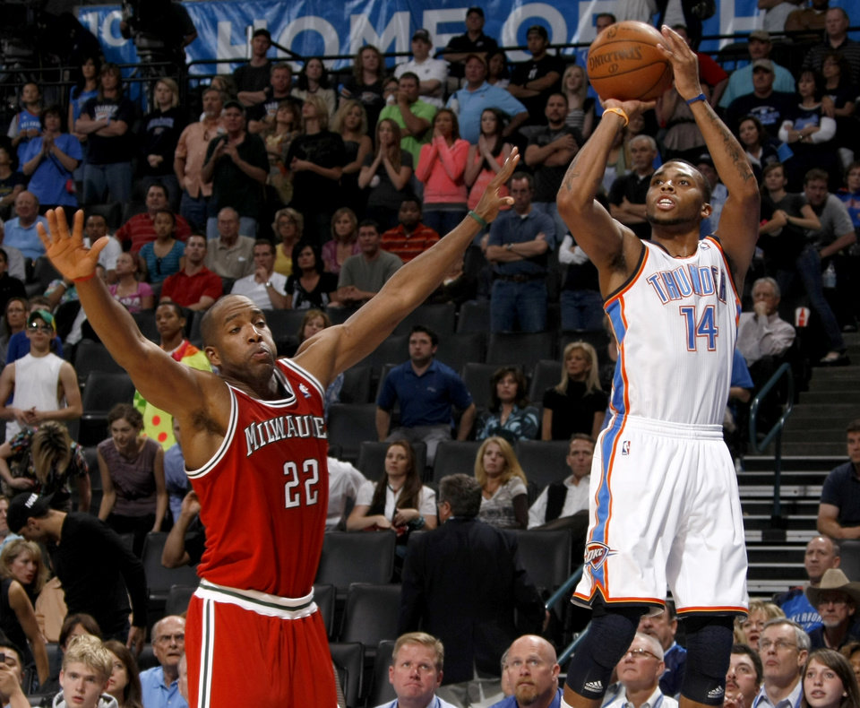 Oklahoma City's Daequan Cook (14) shoots the ball beside Milwaukee's Michael Redd (22) during the NBA basketball game between the Oklahoma City Thunder and the Milwaukee Bucks at the Oklahoma City Arena, Wednesday, April 13, 2011. Photo by Bryan Terry, The Oklahoman ORG XMIT: KOD