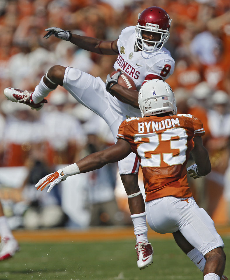 OU's Jalen Saunders (8) makes a catch in front of UT's Carrington Byndom (23) during the Red River Rivalry college football game between the University of Oklahoma Sooners (OU) and the University of Texas Longhorns (UT) at the Cotton Bowl Stadium in Dallas, Saturday, Oct. 12, 2013. The play was called back on a holding penalty.  Photo by Chris Landsberger, The Oklahoman