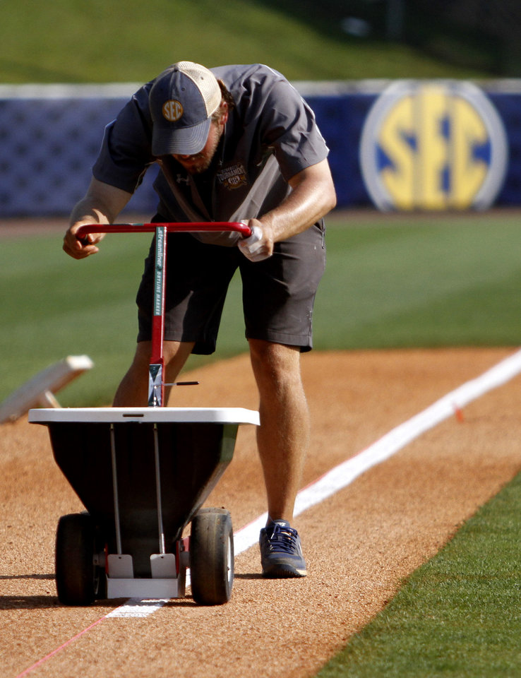 Photo - In this May 22, 2014 photo, Jeff Mondor, of Bradenton, Fla., lines the base line at the Southeastern Conference NCAA college baseball tournament  in Hoover, Ala. (AP Photo/Butch Dill)