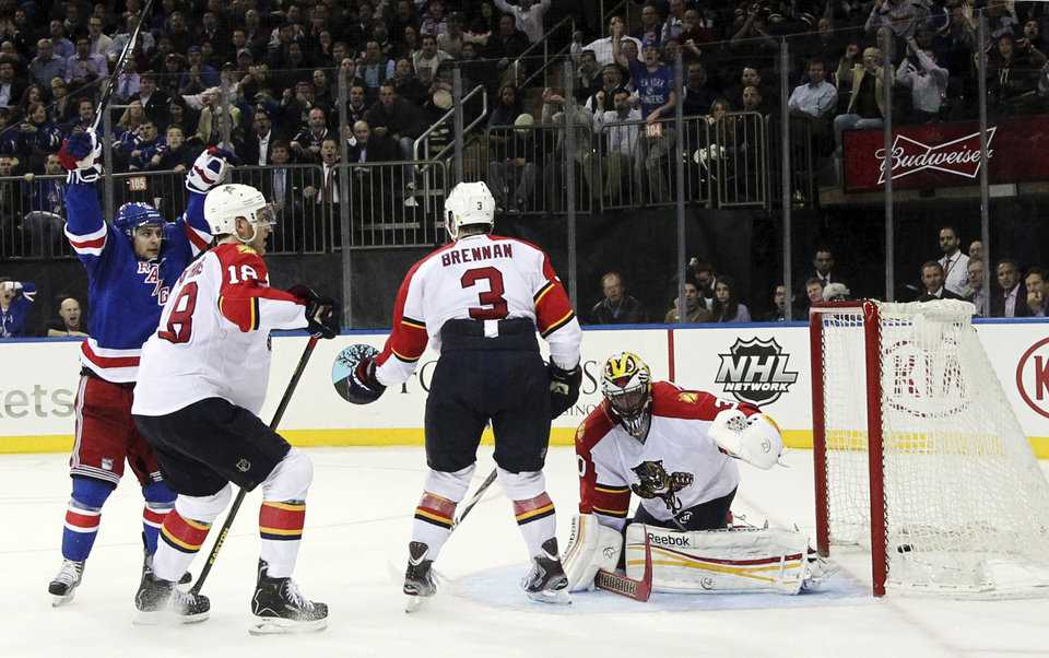 Photo - New York Rangers' Mats Zuccarello, left, of Norway, reacts after scoring a goal against the Florida Panthers during the second period of an NHL hockey game, Thursday, April 18, 2013, at Madison Square Garden in New York. (AP Photo/Mary Altaffer)