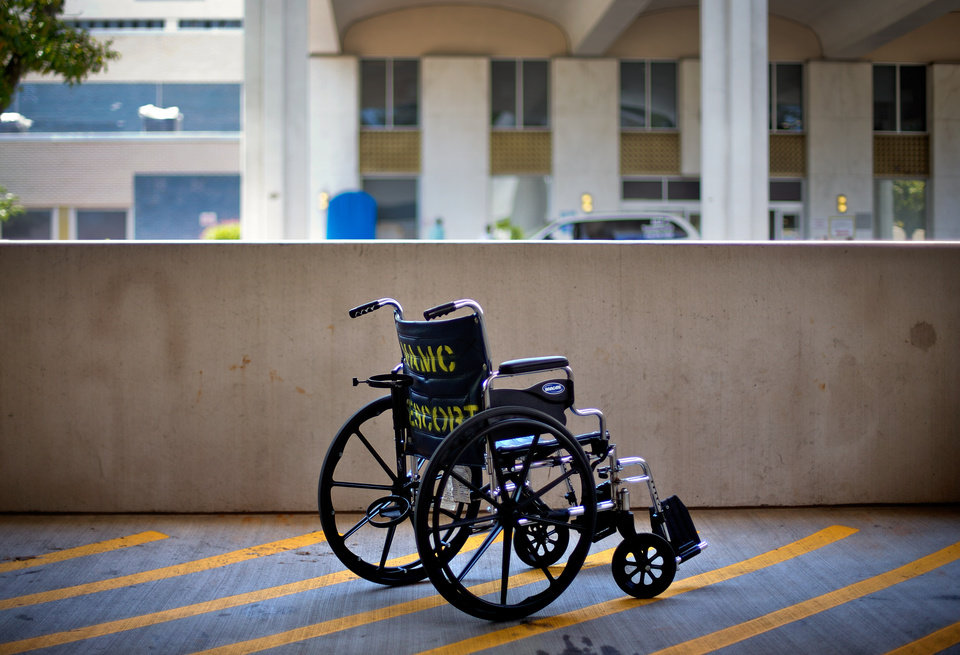 Photo - FILE - In this May 24, 2013 file photo, a wheelchair sits outside the Atlanta VA Medical Center in Atlanta. An internal investigation released in June 2014 that looked at wait times for all sorts of care across the VA system showed that new mental health patients were routinely forced to wait a month or more to start treatment. Not one of the 141 medical systems examined was able to meet the department's goal of getting all new mental health patients an appointment within 14 days. (AP Photo/David Goldman, File)