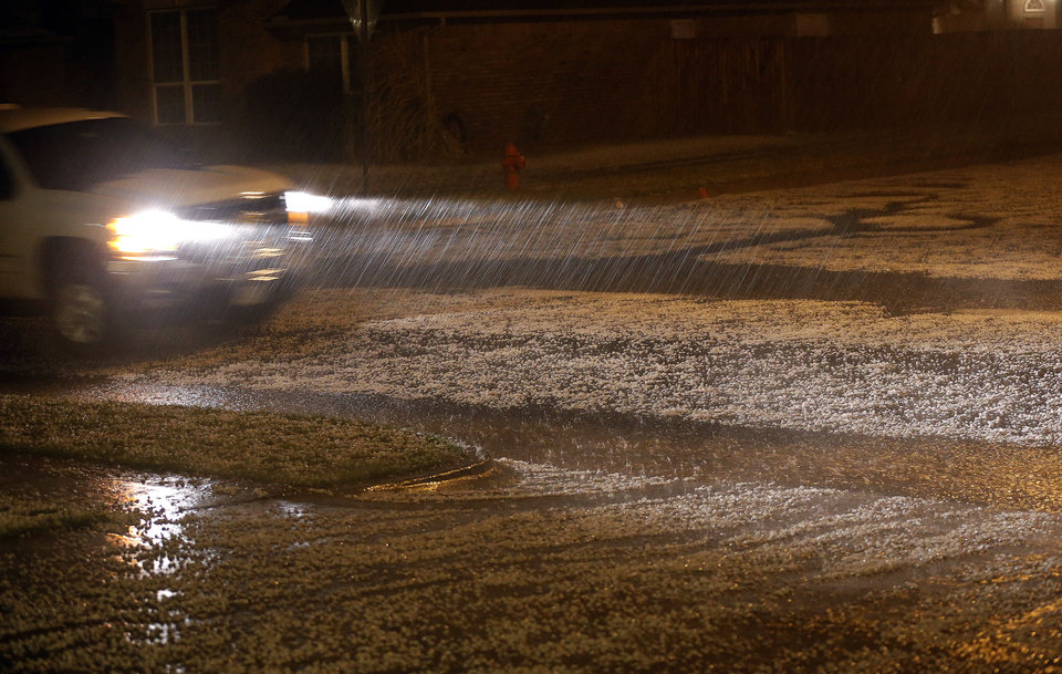 A car drives through hail on the residential street in Northwest Oklahoma City, Friday, April 26, 2013. Photo by Sarah Phipps, The Oklahoman <strong>SARAH PHIPPS - SARAH PHIPPS</strong>