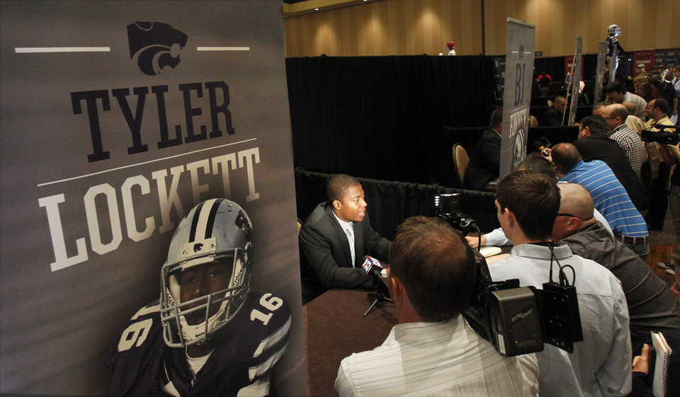 Kansas State wide receiver Tyler Lockett fields questions from members of the media during the Big 12 Conference Football Media Days Monday, July 22, 2013 in Dallas. (AP Photo/Tim Sharp)