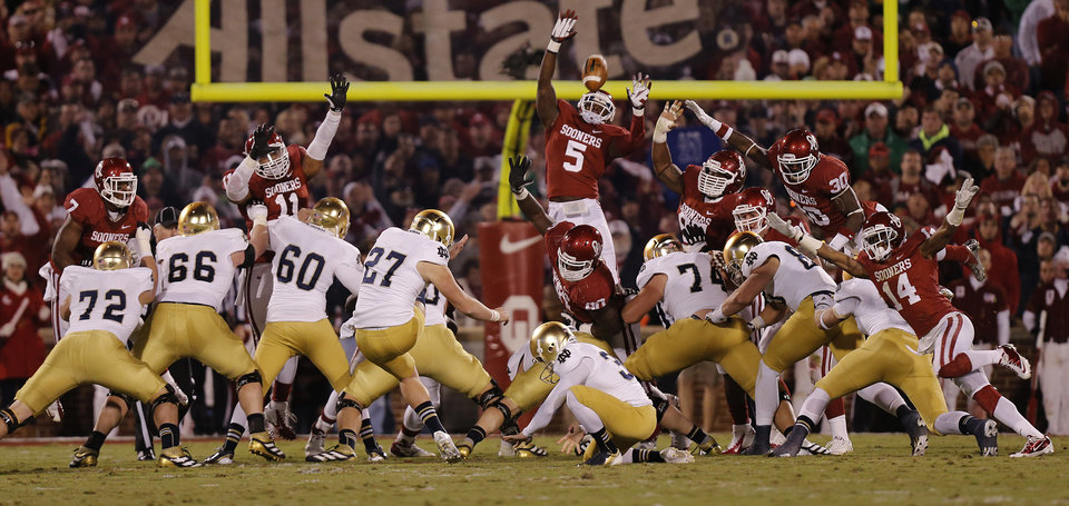 Photo - OU's Joseph Ibiloye (5) tries to block a field goal by Notre Dame during the college football game between the University of Oklahoma Sooners (OU) and the Notre Dame Fighting Irish at the Gaylord Family-Oklahoma Memorial Stadium on Saturday, Oct. 27, 2012, in Norman, Okla. Photo by Chris Landsberger, The Oklahoman