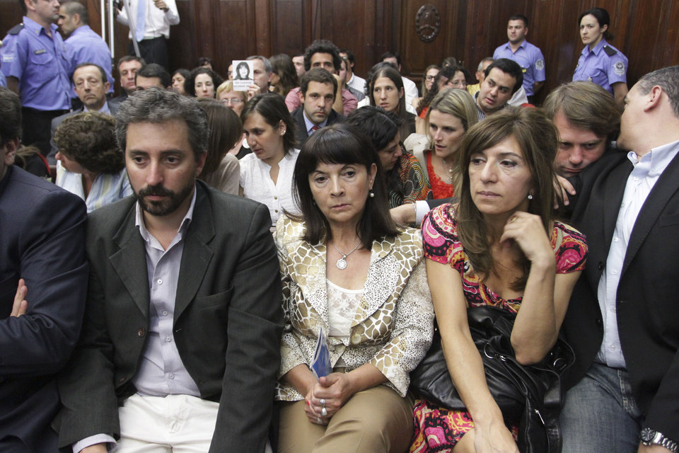 Susana Trimarco, center, listens to the verdict during the trial of the alleged kidnappers of her daughter Marita Veron in San Miguel de Tucuman, Argentina, Tuesday, Dec. 11, 2012. The 13 defendants, who were charged with kidnapping and forcing Veron to be a prostitute in 2002, were found innocent. (AP Photo/Atilio Orellana)