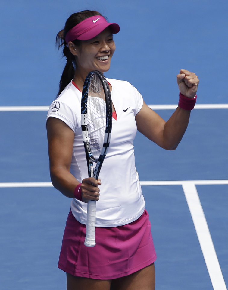 Photo - Li Na of China celebrates after defeating Flavia Pennetta of Italy during their quarterfinal at the Australian Open tennis championship in Melbourne, Australia, Tuesday, Jan. 21, 2014.(AP Photo/Aijaz Rahi)