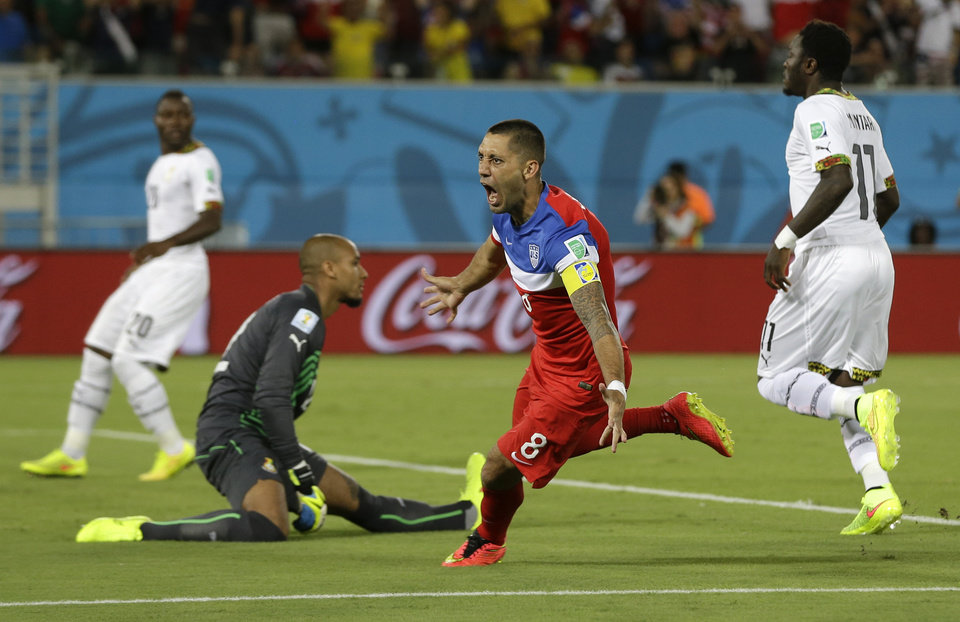 Photo - United States' Clint Dempsey turns away and celebrates after scoring the opening goal during the group G World Cup soccer match between Ghana and the United States at the Arena das Dunas in Natal, Brazil, Monday, June 16, 2014.  (AP Photo/Ricardo Mazalan)