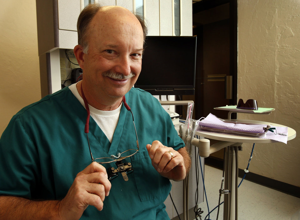 Dr. Craig Herwig, dental director at Variety Care, discusses a root canal procedure. A root canal is a preventable procedure when patients practice good dental hygiene. PHOTO BY STEVE SISNEY, THE OKLAHOMAN