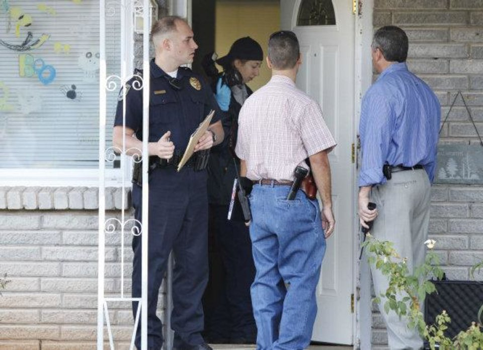 Photo - Midwest City police Investigate the scene of a home invasion and shooting in Midwest City. A woman told police she shot two intruders who broke into her house. By Paul Hellstern, The Oklahoman ORG XMIT: KOD  PAUL HELLSTERN