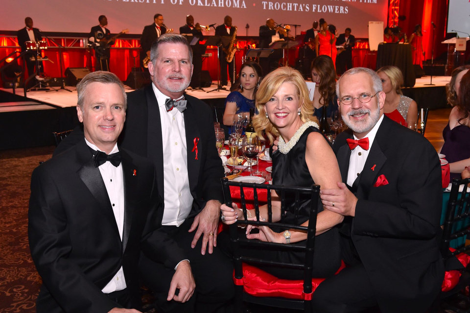 Photo -  The 23rd Annual Red Tie Night benefiting the Oklahoma AIDS Care Fund was March 7 at the Cox Convention Center. From left, Red Tie Night committee member Mark Beutler, Michael Blain, former first lady Kim Henry and former Gov. Brad Henry were among the attendees. Photo provided
