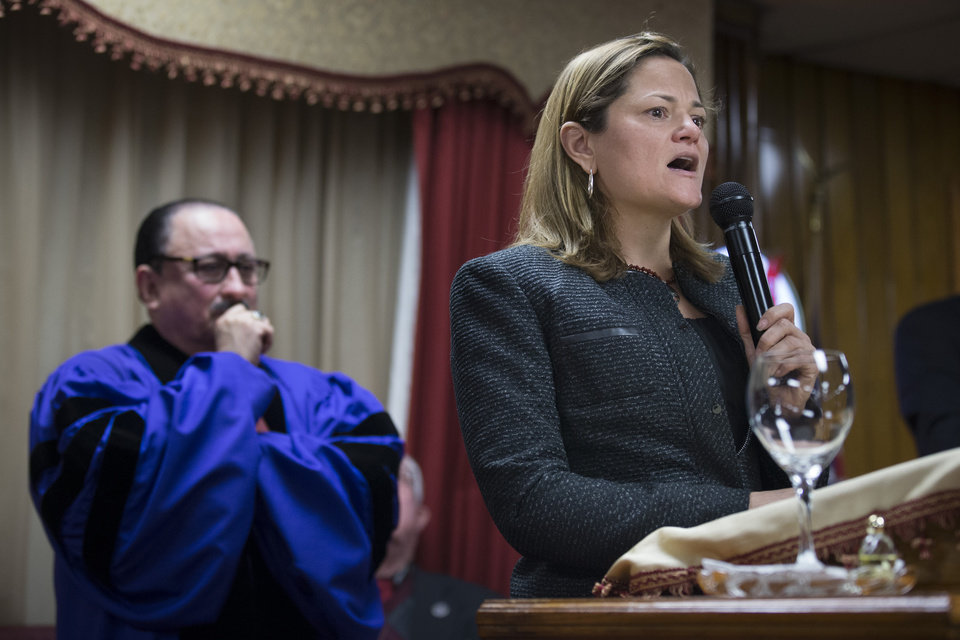 Photo - New York City Council Speaker Melissa Mark-Viverito speaks during Sunday services at the Church of God of Third Avenue as the congregation welcomed members of the Spanish Christian Church that was destroyed by Wednesday's explosion in the East Harlem neighborhood of New York, Sunday, March 16, 2014. The Spanish Christian Church had been located on the first floor of one of the destroyed buildings. On Saturday a crew at the blast site found a large Bible in the rubble and returned it to the church's pastor. (AP Photo/John Minchillo)