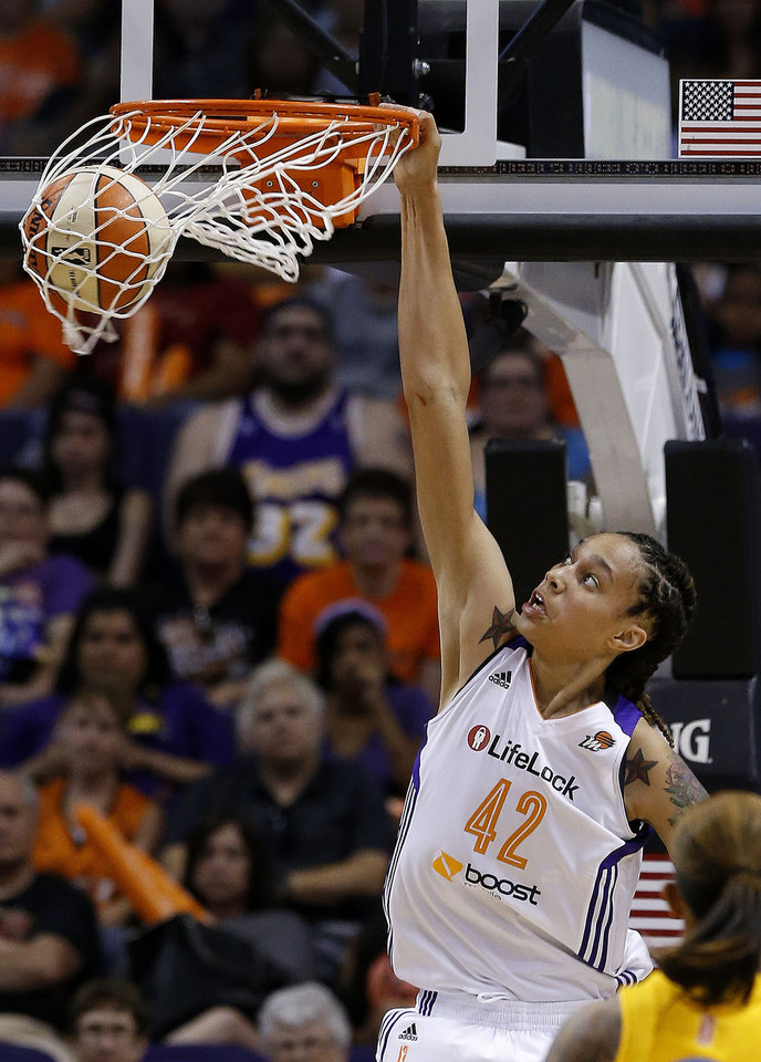 Photo - FILE - In this May 27, 2013, file photo, Phoenix Mercury's Brittney Griner dunks against the Chicago Sky in the second half during a WNBA basketball game in Phoenix. Griner brings her slam-dunking skills to Madison Square Garden for the first time, hoping to take her team a step closer to the WNBA playoffs and a possible league record 30-win season.  (AP Photo/Ross D. Franklin, File)