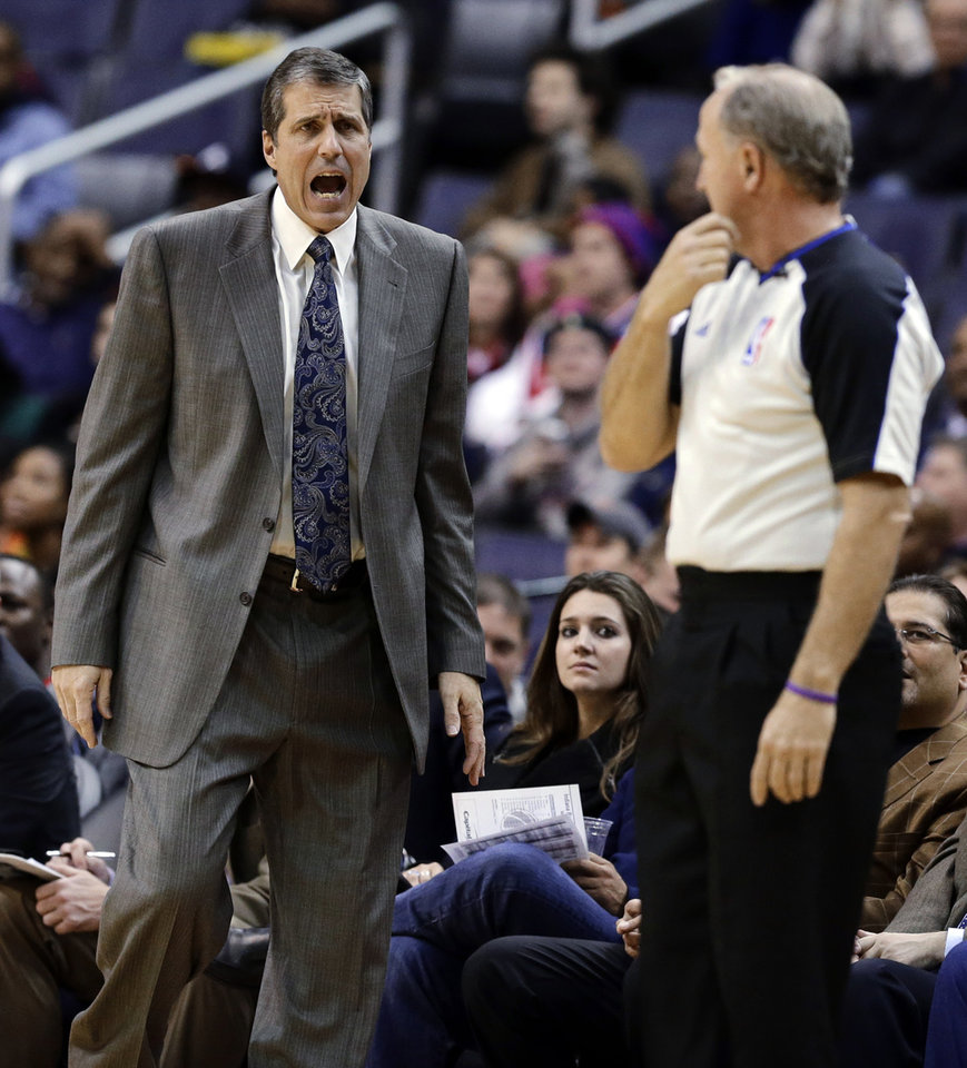 Photo -   Washington Wizards coach Randy Wittman talks with an official in the first half of an NBA basketball game against the Indiana Pacers on Monday, Nov. 19, 2012, in Washington. The Pacers won 96-89. (AP Photo/Alex Brandon)