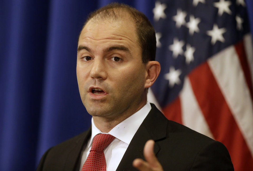 Photo - Deputy National Security Adviser for Strategic Communications and Speechwriting Ben Rhodes speaks to reporters during a press briefing, Friday, Aug. 22, 2014, in Edgartown, Mass., on the island of Martha's Vineyard. Rhodes spoke on issues concerning the situation in Iraq and Ukraine. (AP Photo/Steven Senne)
