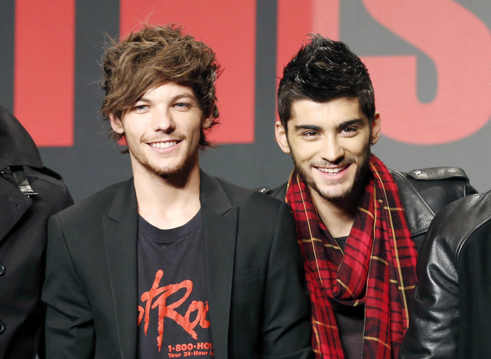 Photo - FILE - This Nov. 3, 2013 file photo shows One Direction members Louis Tomlinson, left, and Zayn Malik during an event for their film