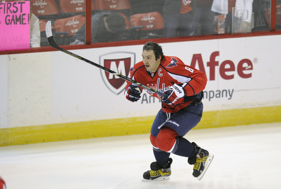 Photo - Washington Capitals right wing Alex Ovechkin (8), of Russia, skates during warm ups before an NHL hockey game against the New York Islanders, Tuesday, Nov. 5, 2013, in Washington. (AP Photo/Nick Wass)