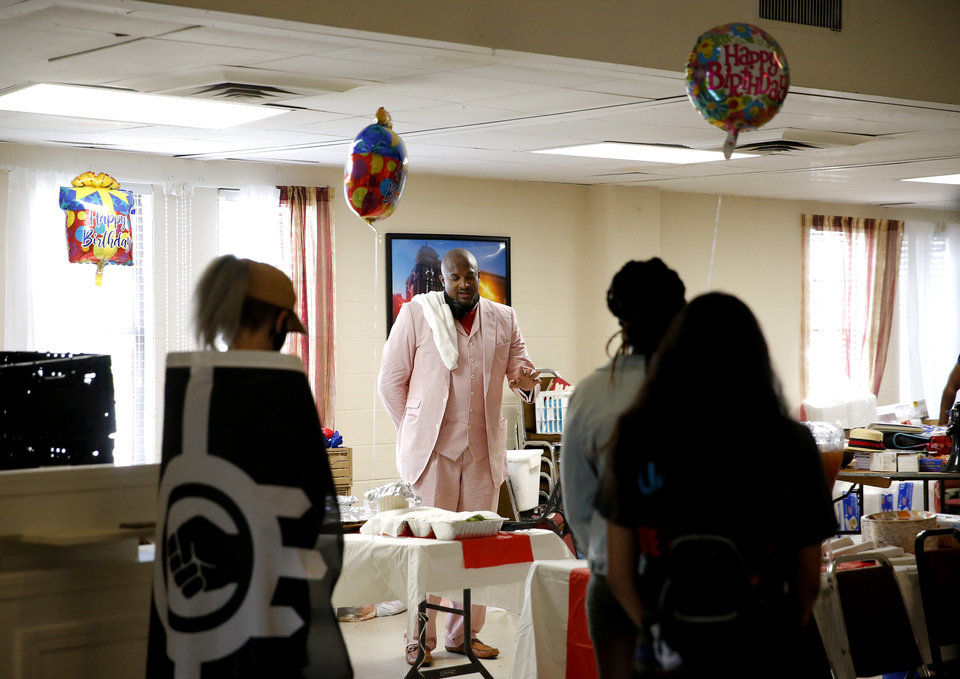 Photo - The Rev. Robert Turner says a prayer before a birthday celebration at the Vernon A.M.E Church in the Greenwood district in Tulsa, Okla., Wednesday, July 29, 2020. Photo by Sarah Phipps, The Oklahoman