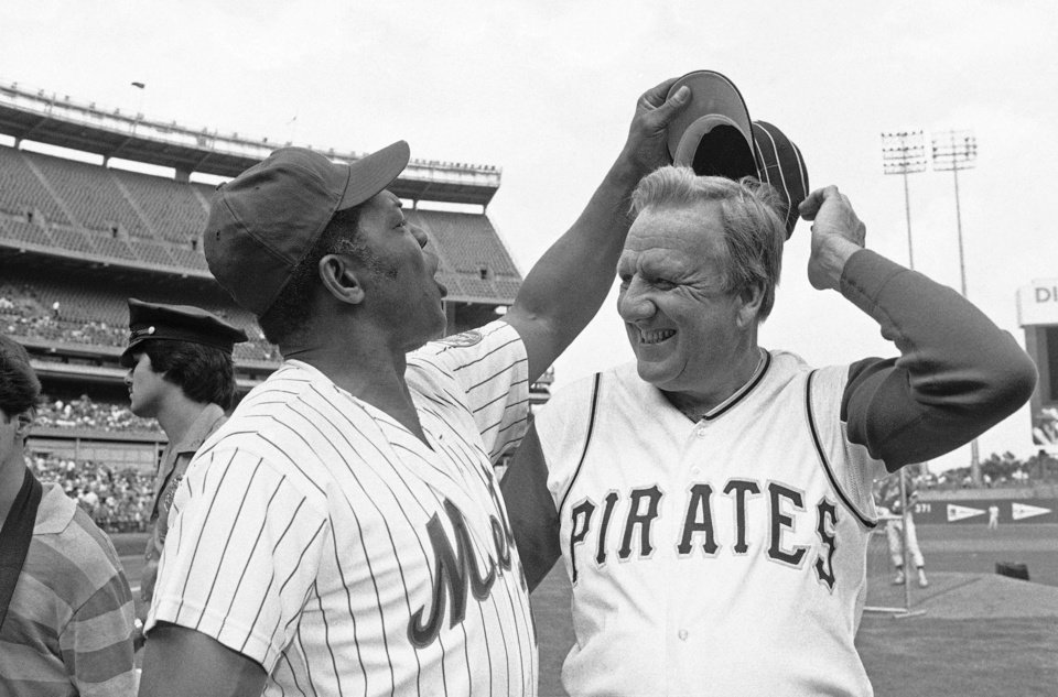 Photo - FILE - In this Aug. 14, 1982 file photo, Willie Mays tries to get Ralph Kinerís hat as the two Hall of Famers pose for pictures before the start of Old Timers Day game at Shea Stadium in New York.  The baseball Hall of Fame says slugger Ralph Kiner has died. He was 91. The Hall says Kiner died Thursday, Feb. 6, 2014, at his home in Rancho Mirage, Calif. (AP Photo/Harry Harris, File)