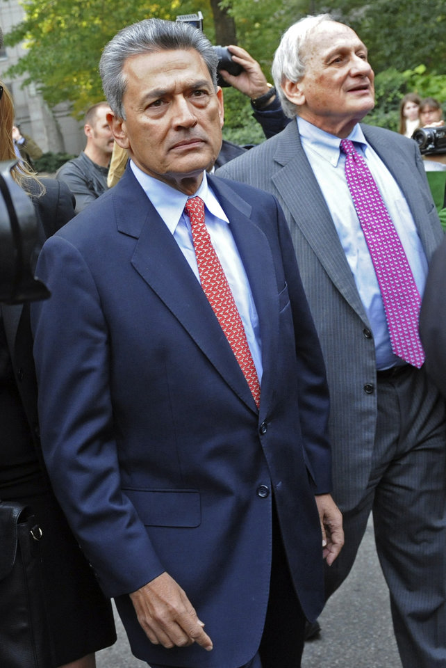 Photo -   FILE - In this Dec. 21, 2009 file photo, Rajat Gupta exits Manhattan federal court in New York with his attorney Gary Naftalis, right, following arraignment. The insider trading trial of the former board member for Goldman Sachs and Procter & Gamble begins in New York on Monday, May 21, 2012, with jury selection. (AP Photo/ Louis Lanzano, File)