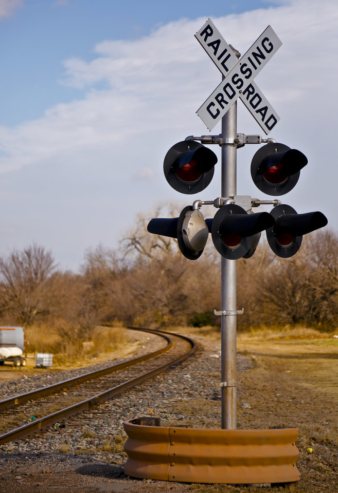 Photo -  A railroad crossing is pictured in Luther. Tuesday, Oklahoma officials announced a $100 million initiative to improve safety at crossings, many of which do not have flashing lights or crossing arms. Photo by Chris Landsberger, The Oklahoman   CHRIS LANDSBERGER -