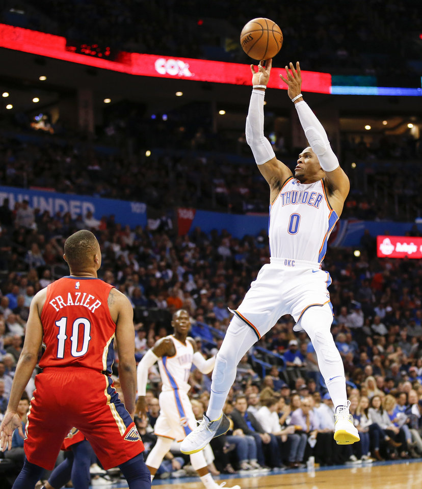 Photo - Oklahoma City's Russell Westbrook (0) shoots in front of New Orleans' Tim Frazier (10) during an NBA basketball game between the Oklahoma City Thunder and the New Orleans Pelicans at Chesapeake Energy Arena in Oklahoma City, Monday, Nov. 5, 2018. Photo by Nate Billings, The Oklahoman