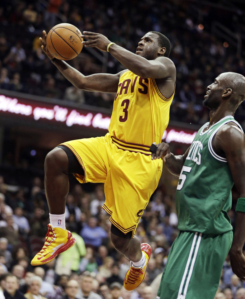 Cleveland Cavaliers' Dion Waiters (3) jumps to the basket against Boston Celtics' Kevin Garnett (5) during the second quarter of an NBA basketball game, Tuesday, Jan. 22, 2013, in Cleveland. (AP Photo/Tony Dejak)