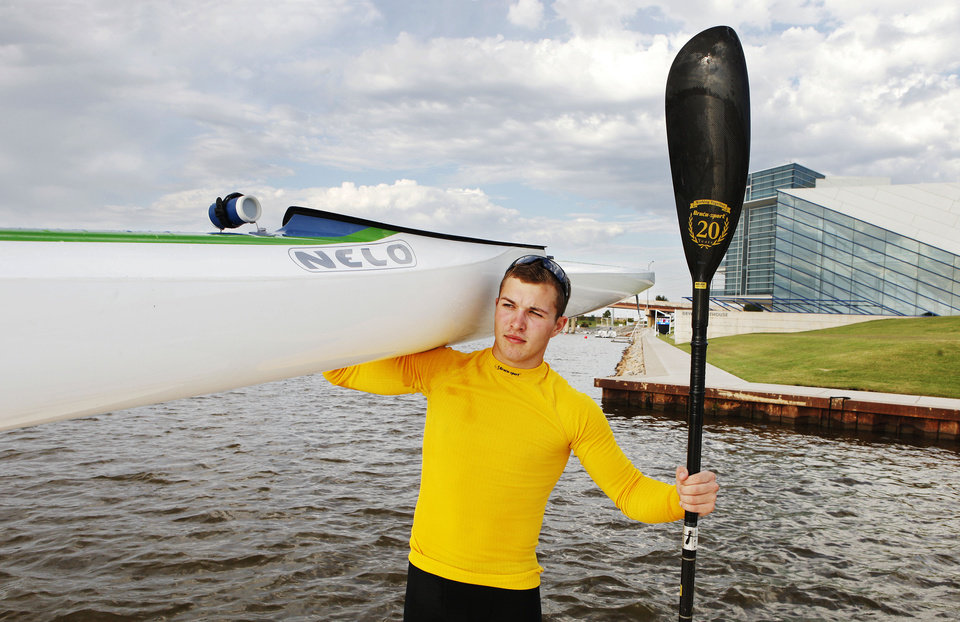 Photo - Oklahoma Riversport Junior Sprint Canoe/Kayak competitor Dylan Puckett, 16, on the Oklahoma Riverat the Devon Boathouse in Oklahoma City Wednesday, Sept. 26, 2012. Photo by Paul B. Southerland, The Oklahoman  PAUL B. SOUTHERLAND - PAUL B. SOUTHERLAND