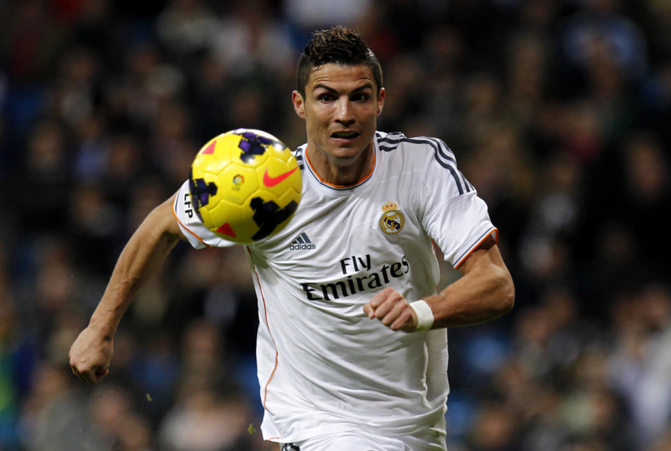 Photo - Real Madrid's Cristiano Ronaldo, from Portugal, chases  the ball during a Spanish La Liga soccer match between Real Madrid and Sevilla at the Santiago Bernabeu stadium in Madrid, Spain, Wednesday Oct. 30, 2013. Ronaldo scored a hat trick in Real Madrid's 7-3 victory. (AP Photo/Francisco Seco)