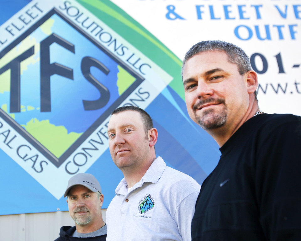 Photo - Total Fleet Solutions staff, left to right, Ted Dumas, Justin Steckman and Greg Worlund pose at their shop in Norman, Monday November 12, 2012. Photo By Steve Gooch, The Oklahoman