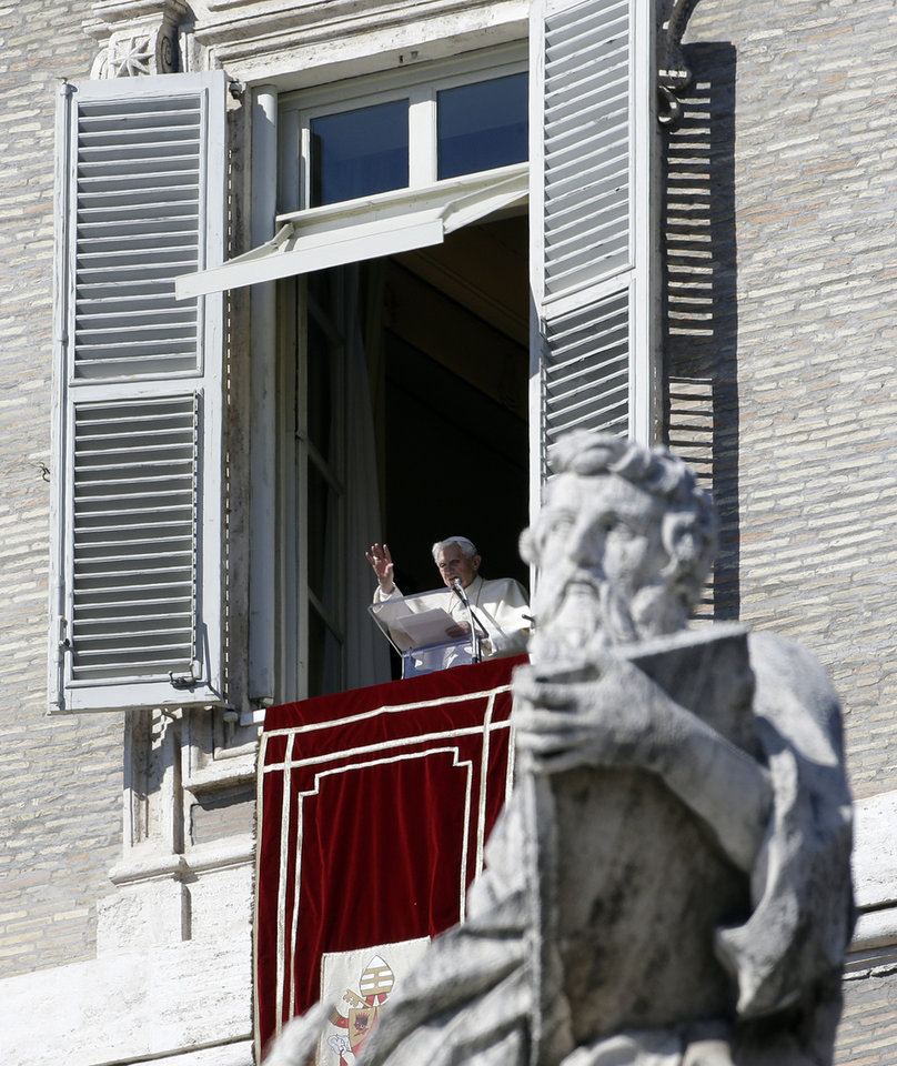 Pope Benedict XVI greets the faithful from his studio's window overlooking St.Peter's square at the end of the Angelus noon prayer, at the Vatican, Sunday, Feb. 10, 2013. (AP Photo/Gregorio Borgia)