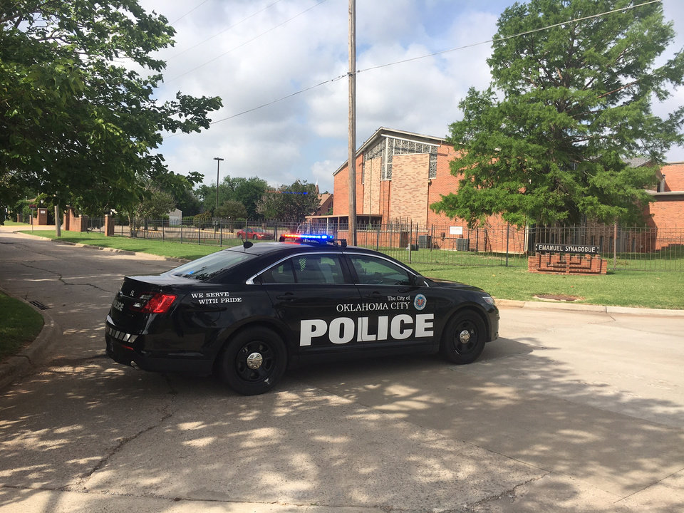 Photo - Police shut down the street near Emanuel Synagogue in Oklahoma City on Thursday morning after a tow truck company found a suspicious device in a parked vehicle. (Photo by Robert Medley)