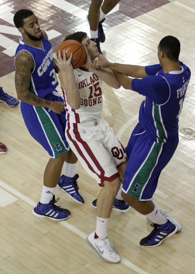Photo - OU: Oklahoma's Tyler Neal (15) fights for the ball with Texas A&M's Zane Knowles (3) and Dale Francis (15) during a college basketball game between the University of Oklahoma and Texas A&M Corpus Christi at McCasland Field House in Norman, Okla., Monday, Dec. 31, 2012.  Photo by Garett Fisbeck, For The Oklahoman