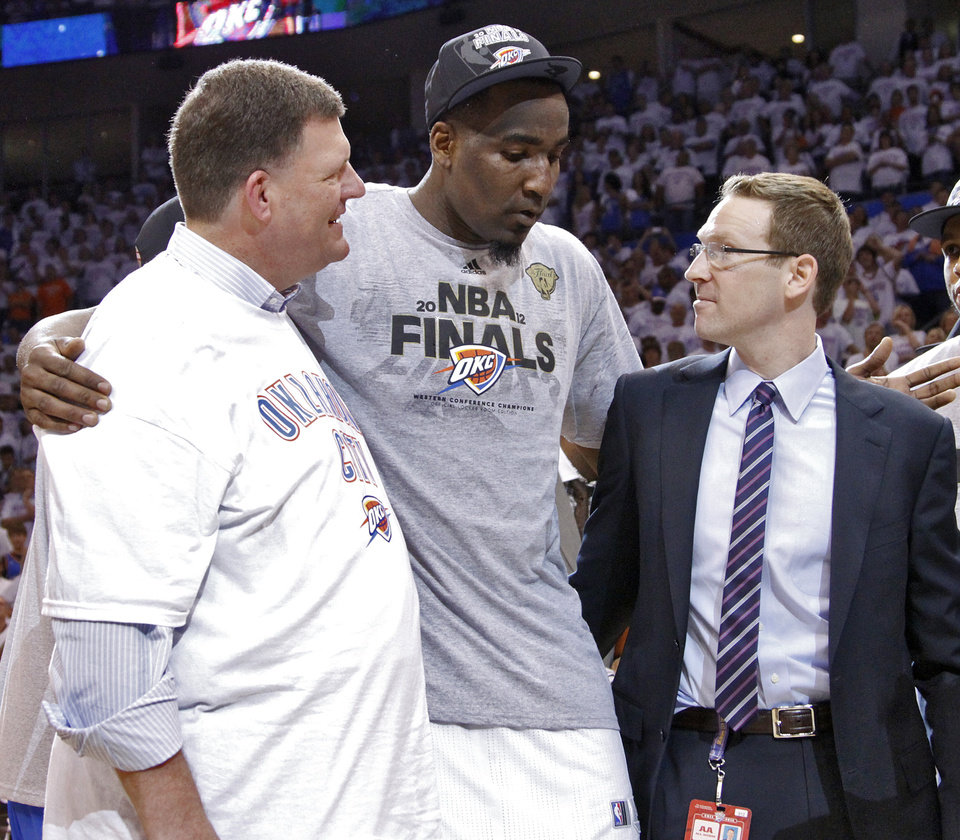 Photo - Oklahoma City Thunder chairman Clay Bennett and general manager Sam Presti talk with Kendrick Perkins as they celebrate after the Thunder's 107-99 win over the Spurs in Game 6 of the Western Conference Finals between the Oklahoma City Thunder and the San Antonio Spurs in the NBA playoffs at the Chesapeake Energy Arena in Oklahoma City, Wednesday, June 6, 2012. Photo by Chris Landsberger, The Oklahoman