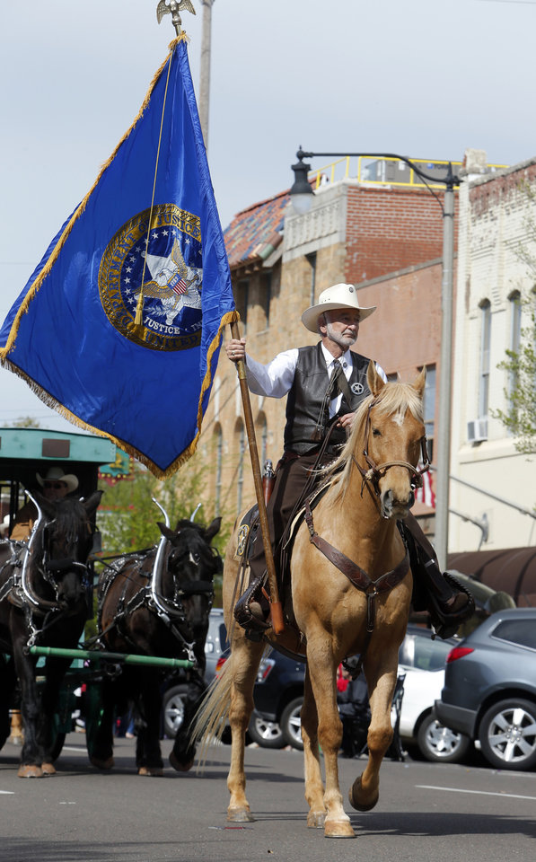 Jim Cline with the Marshall\'s Posse rides in the 89er Day Parade on Saturday, April 20, 2013 in Norman, Okla. Photo by Steve Sisney, The Oklahoman