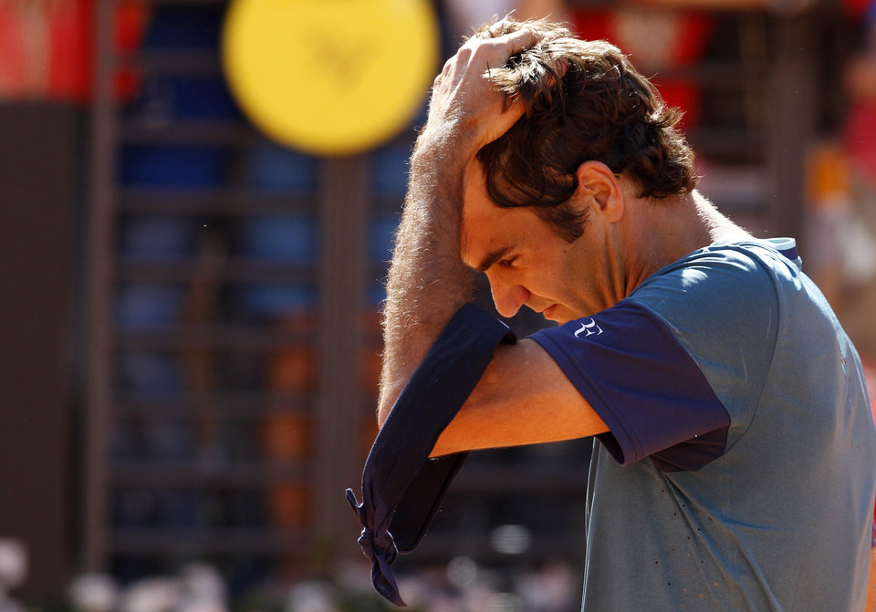 Photo - Switzerland's Roger Federer reacts after being defeated by France's Jeremy Chardy at the Italian open tennis tournament in Rome, Wednesday, May 14, 2014. Roger Federer appeared to lose focus in his first match back after the birth of his second set of twins, losing to 47th-ranked Jeremy Chardy of France 1-6, 6-3, 7-6 (6) in the second round of the Italian Open on Wednesday. (AP Photo/Riccardo De Luca)