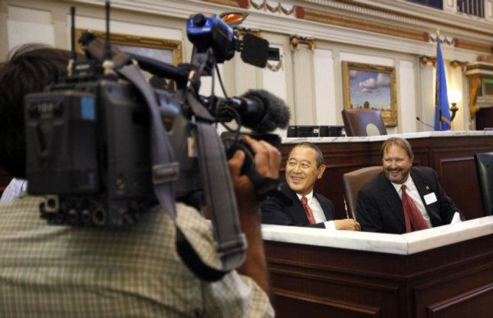 Photo - A Japanese television crew films Japanese ambassador Ichiro Fujisaki and Sen. Randy Bass at the Oklahoma House Chamber, Friday, Aug. 5, 2011. Photo by Sarah Phipps, The Oklahoman ORG XMIT: KOD