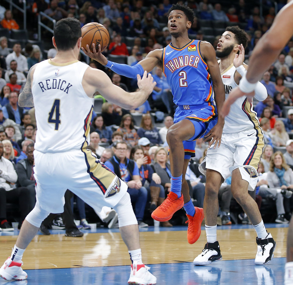 Photo - Oklahoma City's Shai Gilgeous-Alexander (2) goes to the basket between New Orleans' JJ Redick (4) and Kenrich Williams (34) during an NBA basketball game between the Oklahoma City Thunder and the New Orleans Pelicans at Chesapeake Energy Arena in Oklahoma City, Saturday, Nov. 2, 2019. Oklahoma City won 115-104. [Bryan Terry/The Oklahoman]