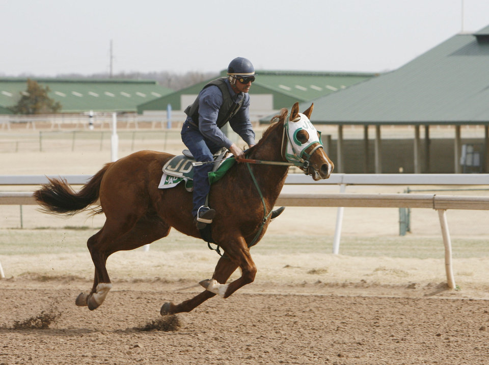 Photo - HORSE RACING / RACE HORSE: A trainer puts a horse through its paces at Remington Park racetrack in Oklahoma City, OK, Friday, March 6, 2009. BY PAUL HELLSTERN, THE OKLAHOMAN ORG XMIT: KOD