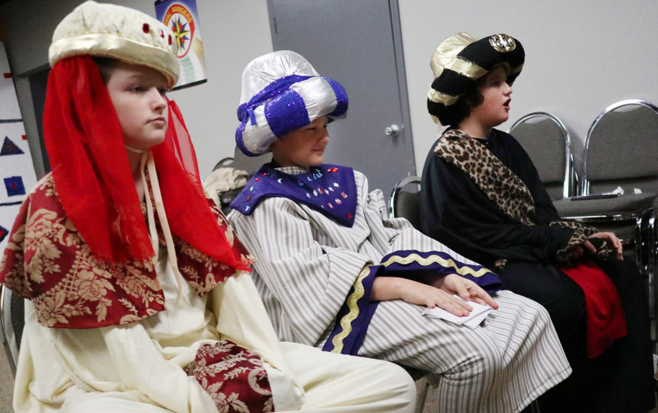 "Photo - Hunter Spears, left, Kyler Plemons, and Daniel Tucker, right, portray the ""Three Wise Men"" during the Christmas in the Hood party at the Oklahoma City Dream Center, Saturday, December 14, 2019. [Photo by Doug Hoke/The Oklahoman]"
