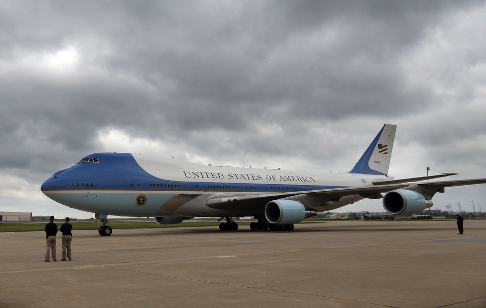 Photo - Air Force One arrives at Tinker Air Force base in Midwest City, Sunday, May 26, 2013. Obama was in town to visit areas damaged by the May 20 tornado. Photo by Sarah Phipps, The Oklahoman