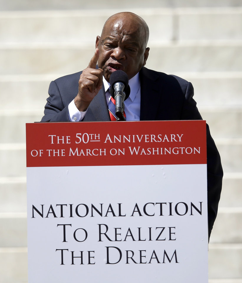 Photo - Rep. John Lewis, D-Ga., speaks at a rally to commemorate the 50th anniversary of the 1963 March on Washington on the steps of the Lincoln Memorial on Saturday, Aug. 24, 2013, in Washington. (AP Photo/Carolyn Kaster)