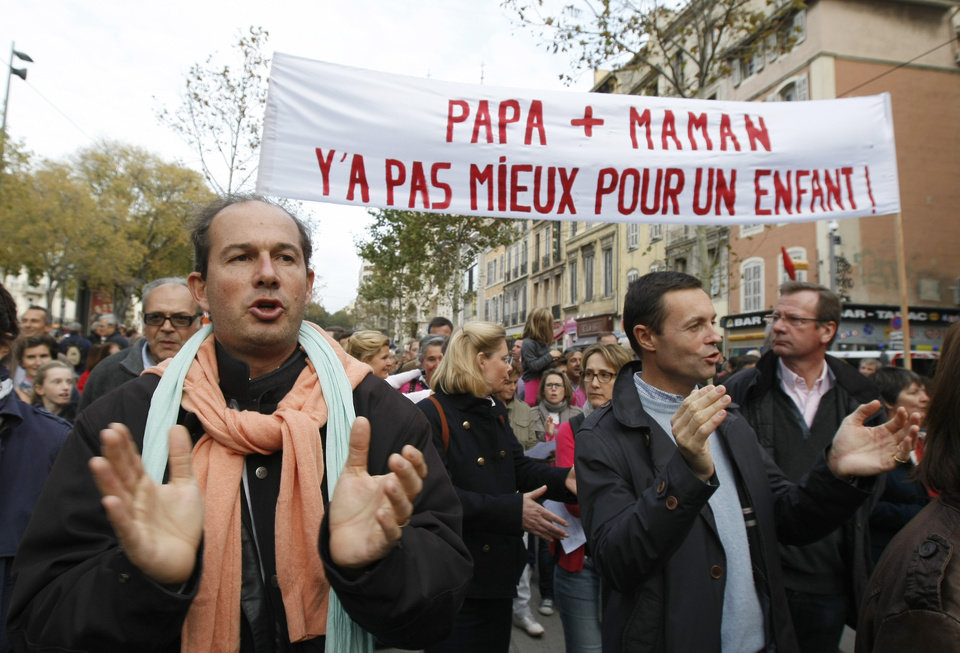 "People demonstrate against the government project to legalize same sex marriage and adoption for same-sex couples, in Marseille, southern France, Saturday, Nov. 17, 2012. Banner reads "" Dad, mom, there aren't better for children"". (AP Photo/Claude Paris)"
