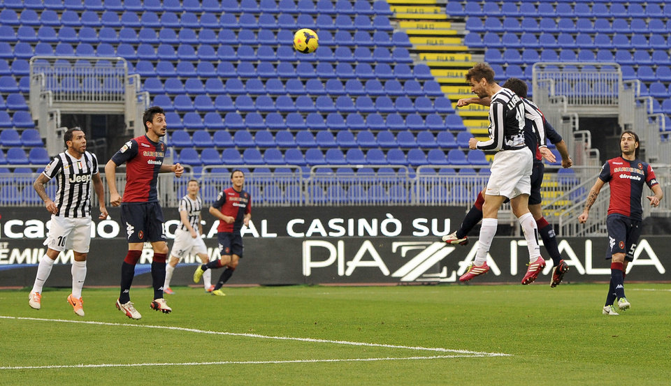 Photo - Juventus striker Fernando Lloriente, third left, scores, during a Serie A soccer match between Juventus and Cagliari, in Cagliari, Italy, Sunday, Jan. 12, 2013. (AP Photo/Daniele Badolato, Lapresse)