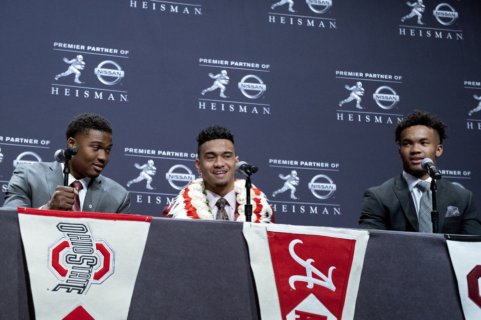 Photo - Heisman Trophy finalists, from left, Dwayne Haskins, from Ohio State; Tua Tagovailoa, from Alabama; and Kyler Murray, from Oklahoma, share a light moment during a media event Saturday, Dec. 8, 2018, in New York. (AP Photo/Craig Ruttle)