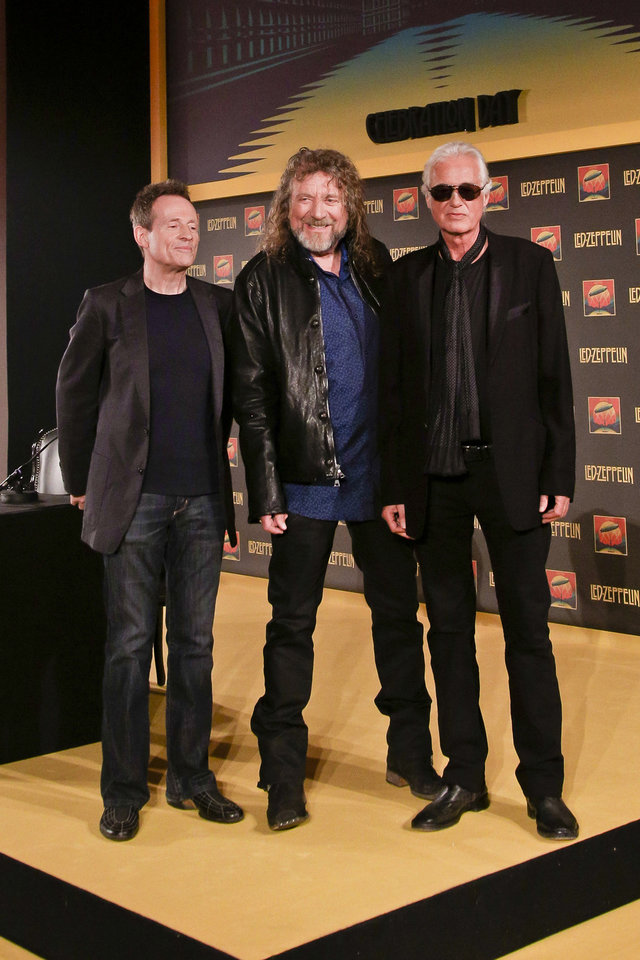 Photo -   Bassist and keyboardist John Paul Jones, from left, frontman Robert Plant and guitarist Jimmy Page pose for photos at a media screening ahead of the worldwide theatrical release of Led Zeppelin's 2007 Celebration Day concert at the O2, on Friday, Sept. 21, 2012, in London. (Photo by Miles Willis/Invision/AP)