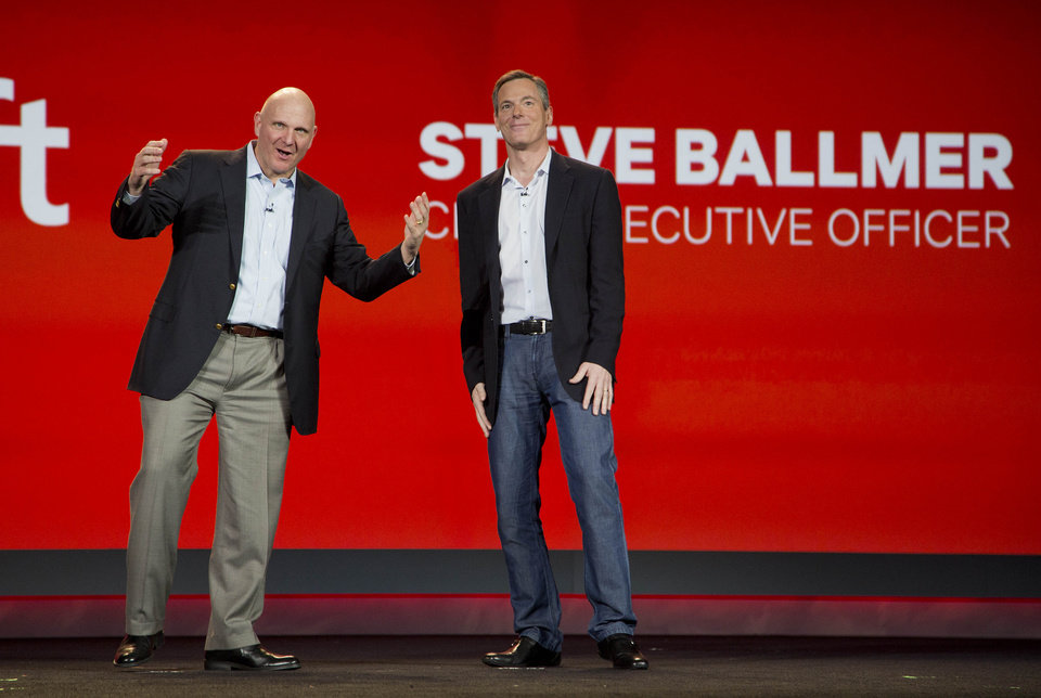 In this Monday, Jan. 7, 2013, file photo, Microsoft CEO Steve Ballmer, left, and Qualcomm CEO Paul Jacobs speak during Jacobs\' keynote address at the Consumer Electronics Show, in Las Vegas. Microsoft\'s latest quarterly earnings for the last quarter of 2012 slipped, even as the world\'s largest software maker showed modest progress adjusting to a shift away from the personal computers that have been its financial foundation for decades. (AP Photo/Julie Jacobson, File)